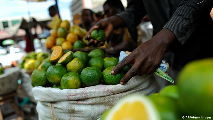 A vendor sells fruits and vegetables at Nakasero market (TONY KARUMBA/AFP/Getty Images)