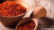 #44764074 - Saffron on wooden background © Kesu