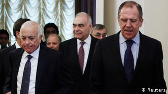 Russian Foreign Minister Sergei Lavrov (R), Egyptian Foreign Minister Mohamed Kamel Amr (C) and Secretary-General of the Arab League Nabil Elaraby (L)