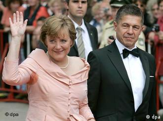 Never let them see you sweat: Merkel and her husband at Bayreuth