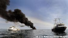 GULF OF MEXICO - MAY 7 : (EDITORS NOTE: Image has been reviewed by U.S. Military prior to transmission.) In this handout image provided by the U.S. Navy, Shrimping vessels Gulf Rambler, left, and Mark and Jace slowly pull a hydro oil boom during a controlled fire May 7, 2010 in the Gulf of Mexico. Efforts continue at containing oil leaking into the gulf from the April 20 explosion and collapse of the Deepwater Horizon offshore oil rig. The U.S. Coast Guard working in partnership with BP PLC, local residents, and other federal agencies conducted the 'in situ burn' to aid in preventing the spread of oil following the April 20 explosion on Mobile Offshore Drilling Unit Deepwater Horizon. (Photo by Jeffery Tilghman Williams/U.S. Navy via Getty Images)
