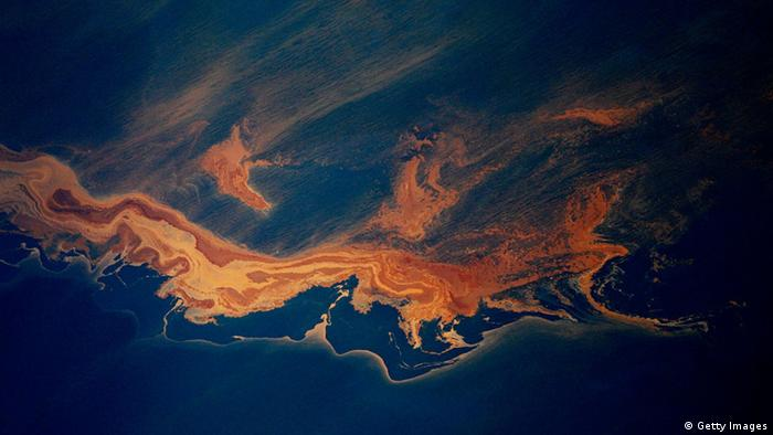 Oil from the Deepwater Horizon wellhead collects on top of the water off the coast of Louisiana (Photo by Chris Graythen/Getty Images)