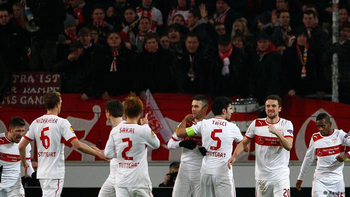 VfB Stuttgart's Christian Gentner (3rdR) celebrates with his team a goal against KRC Genk during their Europa League soccer match in Stuttgart February 14, 2013. REUTERS/Michaela Rehle (GERMANY - Tags: SPORT SOCCER)