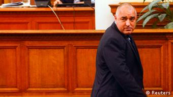 Bulgarian Prime Minister Boiko Borisov walks away after his speech in the Parliament in Sofia February 20, 2013. Bulgaria's government resigned from office on Wednesday after nationwide protests against high electricity prices, joining a long list of European administrations felled by austerity. Prime Minister Borisov had tried to calm protests by sacking his finance minister, pledging to cut power prices and punish foreign-owned companies but the measures failed to defuse discontent and protests continued on Tuesday. REUTERS/Julia Lazarova (BULGARIA - Tags: POLITICS)