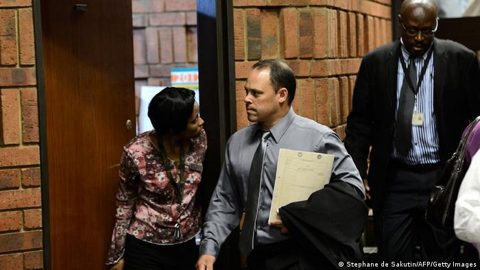 South African police Detective Hilton Botha arrives on February 20, 2013 at the Magistrate Court in Pretoria for South African Olympic sprinter Oscar Pistorius's bail hearing . Pistorius battled on February 20 for a second day to secure bail as he appeared on charges of murdering his model girlfriend Reeva Steenkamp on February 14, Valentine's Day. South African prosecutors will argue that Pistorius is guilty of premeditated murder in Steenkamp's death, a charge which could carry a life sentence. AFP PHOTO / STEPHANE DE SAKUTIN (Photo credit should read STEPHANE DE SAKUTIN/AFP/Getty Images)
