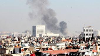 A black pall of smoke rises skywards in the background following a large explosion in central Damascus, Syria 21 February 2013. Reports suggest that the explosion occured near the headquarters of the ruling Baath party and Russian Embassy. EPA/YOUSSEF BADAWI