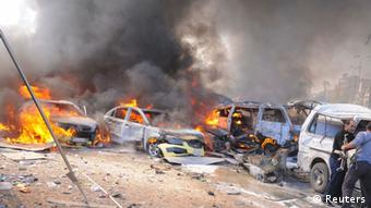 Vehicles burn after an explosion at central Damascus REUTERS/Sana