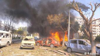Vehicles burn after an explosion at central Damascus