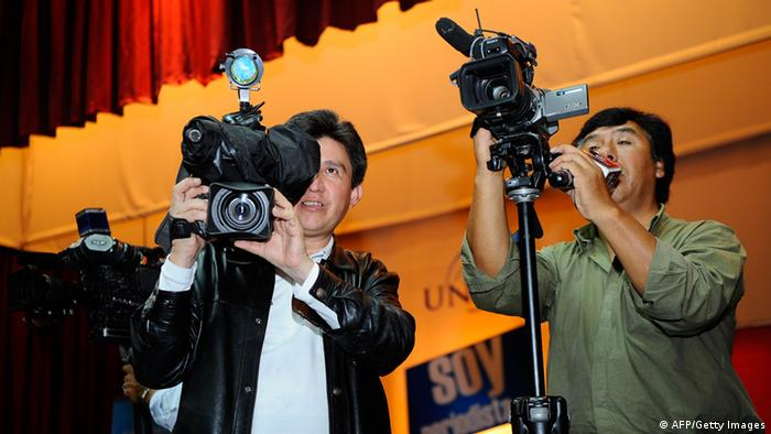 Cameramen shoot the press conference of Investigative journalists and authors of 'Gran Hermano' (Big Brother), Juan Carlos Calderón and Christian Zurita for the release of their book, in Quito, on March 24, 2011 (photo: RODRIGO BUENDIA/AFP/Getty Images).