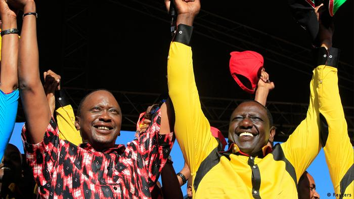 Kenya's Deputy Prime Minister Uhuru Kenyatta (L), who is also the Jubilee alliance presidential candidate (R), and his running mate former cabinet minister William Ruto wave to their supporters during a rally in Kenya's capital Nairobi in this January 12, 2013 file photo. East Africa's most powerful economy and a key regional ally in the U.S.-led war against militant Islam could next month elect a president accused of crimes against humanity, posing a diplomatic headache for Western capitals. If Kenyatta wins the March 4 poll, Kenya will become the second country after Sudan to have a sitting president facing trial at the International Criminal Court in The Hague. Picture taken January 12, 2013. To match story KENYA-ELECTIONS/SANCTIONS REUTERS/Noor Khamis/Files (KENYA - Tags: ELECTIONS POLITICS)
