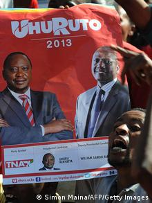 Supporters of The National Alliance hold a poster of Kenya's Deputy Prime Minister and Jubilee Alliance Presidential candidate in the upcoming Presidential elections, Uhuru Kenyatta (L) and running mate William Ruto , during a plotical rally in the capital Nairobi on February 13, 2013. Kenya's eight presidential candidates held the country's first ever face-to-face debate this week as tensions mount ahead of next month's election, five years after bloody violence erupted in the wake of the last vote. While two main candidates -- Uhuru Kenyatta and Raila Odinga -- dominate the race for the March 4 election, all the hopefuls have potential influence, especially if voting goes to a second round run-off. AFP PHOTO / SIMON MAINA (Photo credit should read SIMON MAINA/AFP/Getty Images)