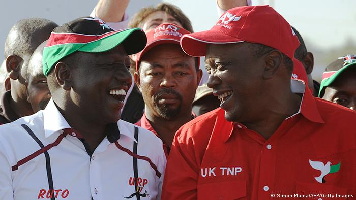 Uhuru Kenyatta speaking with running mate William Ruto
