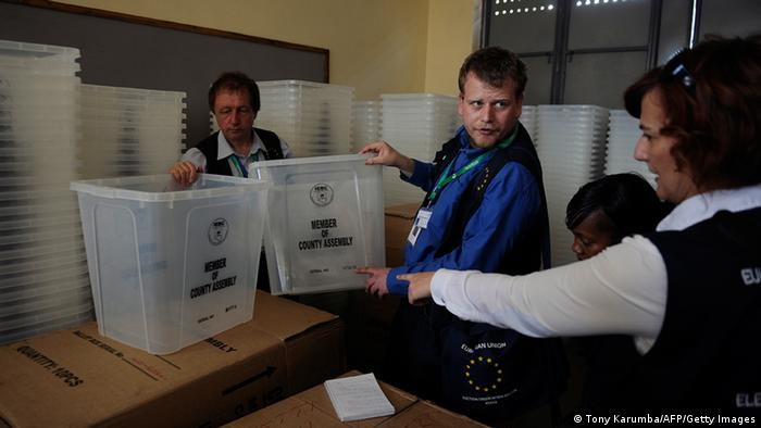 Election observers from the European Union Election Observation Mission (EU EOM) check ballot materials in a warehouse on February 13, 2013 in the Kenyan capital Nairobi, where they observed and had a discussion with poll-officials from the Independent Electoral and Boundaries Commission (IEBC). The March 4 polls are the first since bloody post-election violence five years ago, when what began as political riots quickly turned into deadly ethnic violence which as a result has steeped massive pressure on authorities to conduct a transparent elective process and has seen the east African nation employ modern systems such as biometrics in registration and polling processes. Kenya's foreign minister accused European diplomats on February 11 of trying to influence upcoming presidential elections, where a key candidate faces trial for crimes against humanity. AFP PHOTO / Tony KARUMBA (Photo credit should read TONY KARUMBA/AFP/Getty Images)