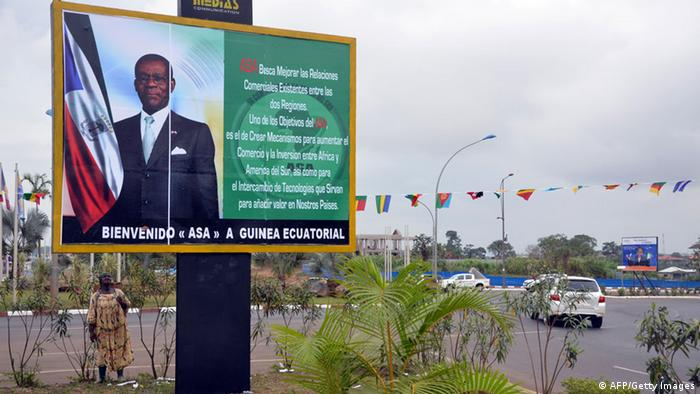 A bilboard sign with a picture of President Obiang nguema in Malabo