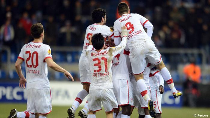 VfB Stuttgart's players celebrate after scoring against KRC Genk during their Europa League soccer match in Genk February 21, 2013. REUTERS/Laurent Dubrule (BELGIUM - Tags: SPORT SOCCER)