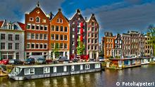 Amsterdam houses and houseboats, Netherlands, HDR photo. aged; amsterdam; ancient; architectural; architecture; blocks; brick; buildings; business; canal; center; centre; city; crane; design; durability; dutch; europe; european; exterior; famous; gabled; gables; gracht; hdr; holland; home; home fronts; houseboat; houses; housing; lodging; netherlands; old; place; river; street; structure; style; summer; tourism; tourist; town; traditional; travel; unique; view; water; windows; yard
