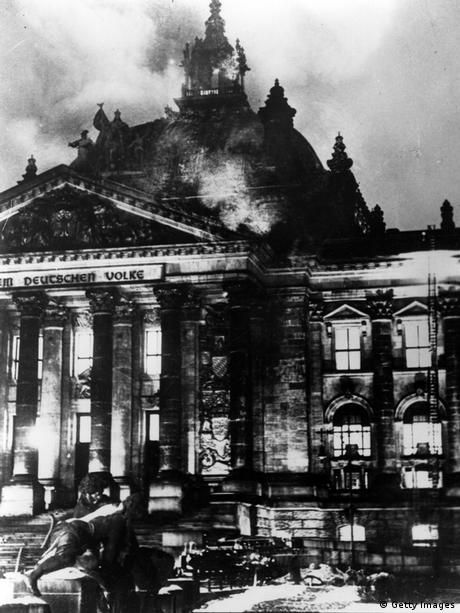 GettyImages 2658536 The Reichstag in flames during the Nazi ascent to power in Berlin. (Photo by Fox Photos/Getty Images)