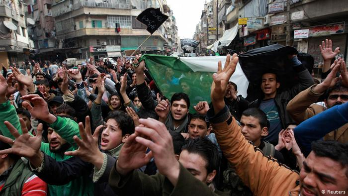 Demonstrators chant slogans and wave Syrian opposition flags during a protest against Syria's President Bashar al-Assad in Bustan al-Qasr district in Aleppo February 22, 2013. REUTERS/Muzaffar Salman (SYRIA - Tags: CONFLICT POLITICS CIVIL UNREST)