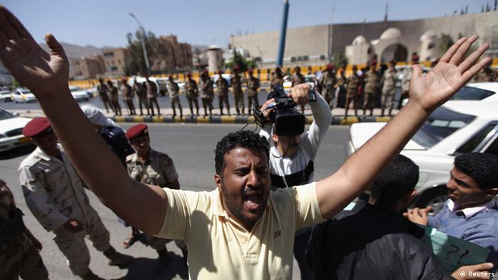 A protester shouts slogans denouncing violence in the country's south during a demonstration in Sanaa February 23, 2013. REUTERS/Mohamed al-Sayaghi (YEMEN - Tags: POLITICS CIVIL UNREST)