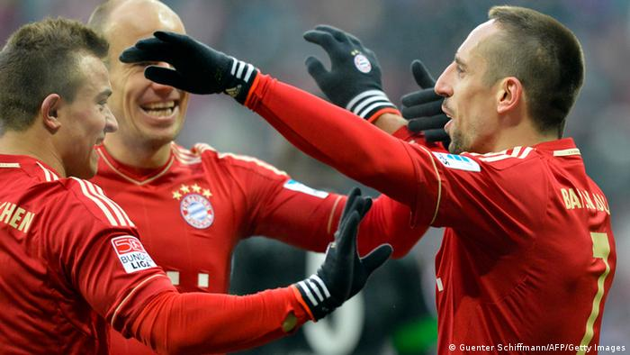 (L-R) Bayern Munich's Swiss midfielder Xherdna Shaqiri, Dutch midfielder Arjen Robben and French midfielder Franck Ribery celebrate during the German first division Bundesliga football match FC Bayern Munich vs SV Werder Bremen in Munich, southern Germany on February 23, 2013. (Photo: AFP/GUENTER SCHIFFMANN) DFL RULES TO LIMIT THE ONLINE USAGE DURING MATCH TIME TO 15 PICTURES PER MATCH. IMAGE SEQUENCES TO SIMULATE VIDEO IS NOT ALLOWED AT ANY TIME. FOR FURTHER QUERIES PLEASE CONTACT THE DFL DIRECTLY AT + 49 69 650050. (Photo credit should read GUENTER SCHIFFMANN/AFP/Getty Images)