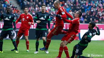 Bayern Munich's Arjen Robben (3rd R) scores a goal next to teammate Franck Ribery (2nd R) during their German Bundesliga first division soccer match against Werder Bremen in Munich February 23, 2013. REUTERS/Michaela Rehle (GERMANY - Tags: SPORT SOCCER TPX IMAGES OF THE DAY) DFL RULES TO LIMIT THE ONLINE USAGE DURING MATCH TIME TO 15 PICTURES PER GAME. IMAGE SEQUENCES TO SIMULATE VIDEO IS NOT ALLOWED AT ANY TIME. FOR FURTHER QUERIES PLEASE CONTACT DFL DIRECTLY AT + 49 69 650050