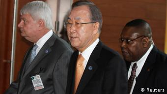 U.N. Secretary General Ban Ki-moon (C) arrives for the signing ceremony of the Peace, Security and Cooperation Framework for the Democratic Republic of Congo and the Great Lakes, at the African Union headquarters in Ethiopia's capital Addis Ababa Feburary 24, 2013. A U.N .-mediated peace deal aimed at ending two decades of conflict in the east of the Democratic Republic of Congo was signed on Sunday by leaders of Africa's Great Lakes region in the Ethiopian capital Addis Ababa. REUTERS/Tiksa Negeri (ETHIOPIA - Tags: POLITICS CIVIL UNREST)
