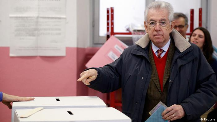Outgoing Prime Minister Mario Monti gestures before casting his vote at the polling station in Milan, February 24, 2013. Italians began voting on Sunday in one of the most closely watched elections in years, with markets nervous about whether it can produce a strong government to pull Italy out of recession and help resolve the euro zone debt crisis. REUTERS/Stefano Rellandini (ITALY - Tags: POLITICS ELECTIONS)