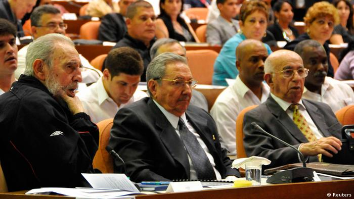 Former Cuban leader Fidel Castro, (L), attends the opening session of the National Assembly of the Peoples Power beside his brother, Cuban President Raul Castro, and First Vice President Ramon Machado Ventura, (R), in Havana February 24, 2013. REUTERS/AIN FOTO/Marcelino Vazquez