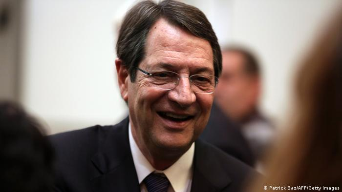 Newly elected Cyprus' President Nicos Anastasiades smiles as he is greeted by supporters as he arrives for a press conference in Nicosia on February 24, 2013. Anastasiades won the presidential election in Cyprus, securing a mandate to negotiate a crucial bailout for the EU state on the brink of bankruptcy. AFP PHOTO/PATRICK BAZ (Photo credit should read PATRICK BAZ/AFP/Getty Images)