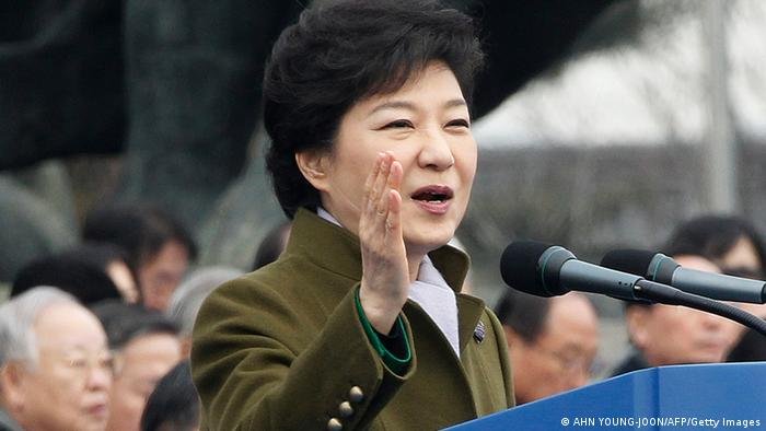 New South Korean President Park Geun-hye salutes during her inauguration ceremony as the 18th South Korean president at the National Assembly in Seoul on Februay 25, 2013.