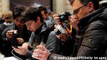 People take pictures of Huawei's new smartphone 'Ascend P2' after a press conference in Barcelona on February 24, 2013, a day before the start of the 2013 Mobile World Congress. The 2013 Mobile World Congress, the world's biggest mobile fair, is held from February 25 to February 28 in Barcelona. AFP PHOTO / JOSEP LAGO (Photo credit should read JOSEP LAGO/AFP/Getty Images)