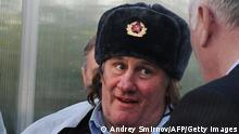 French actor Gerard Depardieu wears Russian military winter hat as he visits 'Teplichnoye' agricultural farm in a village of Ozerny outside Saransk, on February 23, 2013. French actor and newly-minted Russian citizen Gerard Depardieu on Saturday formally registered as resident of the little-known Russian region of Mordovia, giving his residence as No. 1, Democracy Street. AFP PHOTO / ANDREY SMIRNOV (Photo credit should read ANDREY SMIRNOV/AFP/Getty Images)