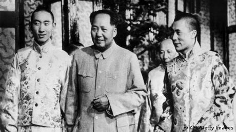 In this 1956 picture the two spiritual leaders of Tibet, the rival Panchen (L) and Dalai Lamas (R), are shown flanking their 'protector', Mao Zedong, Chairman of the People's Republic of China, in Beijing. Communist China announced 28 March 1959 that it had deposed the Dalai Lama and set up a new government in rebellious Tibet under the Panchen Lama. The late Panchen Lama (1938-89), a spiritual leader and teacher in Tibetan Buddhism (second in importance to the Dalai Lama), was said to be reincarnation of the Buddha Amitabha. He became the ward of the Chinese in his childhood, and some Tibetans disputed his status. Dalai Lama or Tenzin Gyatso, born in 1935, is the traditional religious and temporal head of Tibet's Buddhist clergy . In March 1959, there was an unsuccessful armed uprising by Tibetans against Chinese rule. As a result, the Dalai Lama, fled with some 100,000 supporters to northern India, where a government-in-exile was established. The Chinese ended the the former dominance of the lamas (Buddhist monks) and destroyed many monasteries. Tibet (Xizang), occupied in 1950 by Chinese Communist forces, became an 'Autonomous Region' of China in September 1965, but the majority of Tibetans have continued to regard the Dalai Lama as their 'god-king' and to resent the Chinese presence, leading to intermittent unrest. (Photo credit should read -/AFP/Getty Images)