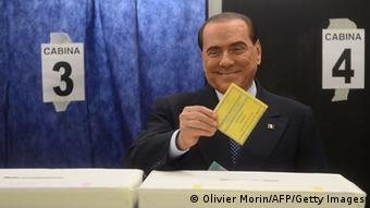 Italian former Prime Minister Silvio Berlusconi casts his ballot at a polling station on February 24, 2013 in Milan. Italians fed up with austerity went to the polls on Sunday in elections where the centre-left is the favourite, as Europe held its breath for signs of fresh instability in the eurozone's third economy. AFP PHOTO / OLIVIER MORIN (Photo credit should read OLIVIER MORIN,OLIVIER MORIN/AFP/Getty Images)
