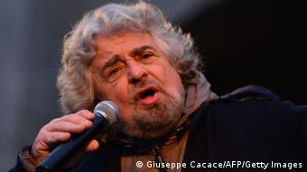 The head of the populist Five Star Movement, comedian Beppe Grillo, whose has been winning votes among those critical of Monti's austerity policy, addresses supporters during an electoral rally on February 12, 2013 in Bergamo, northern Italy. Comedian-turned-politician Beppe Grillo is candidate to the general elections on February 24-25. AFP PHOTO / GIUSEPPE CACACE (Photo credit should read GIUSEPPE CACACE/AFP/Getty Images)