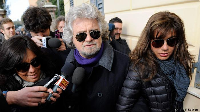 Five Star Movement leader and comedian Beppe Grillo and his wife Parvin Tadjik arrive to cast their votes at the polling station in Genoa February 25, 2013. (Photo: REUTERS/Giorgio Perottino)