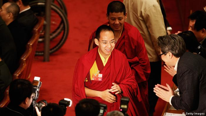 The Panchen Lama (C), the second highest Tibetan Buddhist leader, arrives the closing session of the National Committee of the Chinese People's Political Consultative Conference (CPPCC) at the Great Hall of the People on March 13, 2012 in Beijing, China. Known as 'liang hui,' or 'two organizations', it consists of meetings of China's legislature, the National People's Congress (NPC), and its advisory auxiliary, the Chinese People's Political Consultative Conference (CPPCC). (Photo by Lintao Zhang/Getty Images)