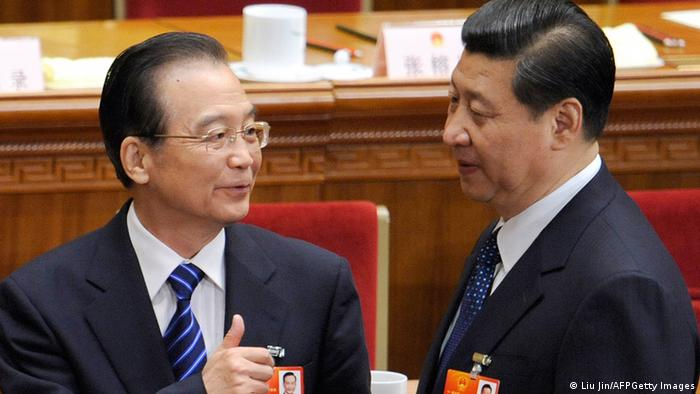 Chinese Premier Wen Jiabao (L) talks with Vice President Xi Jinping (R) after the fourth plenary meeting of the National People's Congress's (NPC) annual session at the Great Hall of the People in Beijing on March 11, 2012. Proposed changes to China's criminal law being debated this week by the parliament originally included a clause that allowed police to hold people suspected of terrorism or endangering national security in secret locations without notifying their families. AFP PHOTO / LIU JIN (Photo credit should read LIU JIN/AFP/Getty Images)