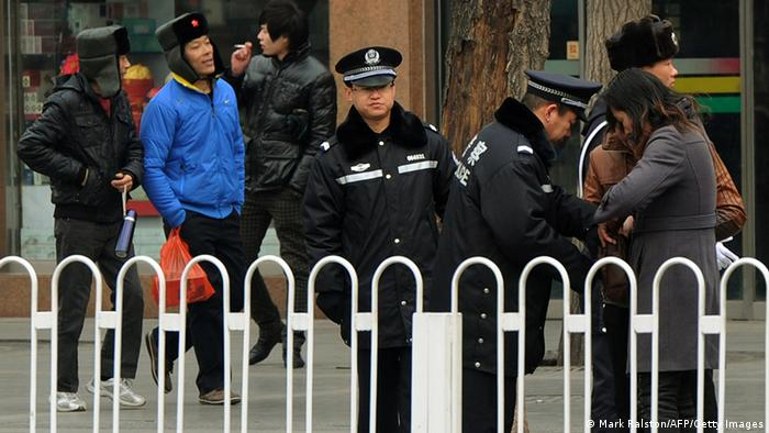 Police search people outside the Great Hall of the People before the opening session at the 11th National Committee of the Chinese People's Political Consultative Conference (CPPCC) in Beijing on March 3, 2012. China's parliament, also called the National People's Congress (NPC), will open its last annual session under the current leadership on March 5, amid what analysts say may be a bitter power struggle to replace outgoing Communist Party rulers. AFP PHOTO / Mark RALSTON (Photo credit should read MARK RALSTON/AFP/Getty Images)