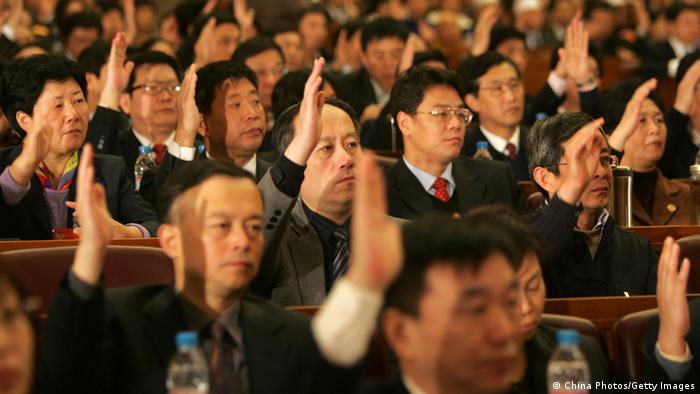 Delegates vote during the first Session of the 11th Beijing Municipal Committee of Chinese People's Political Consultative Conference (Photo by China Photos/Getty Images)