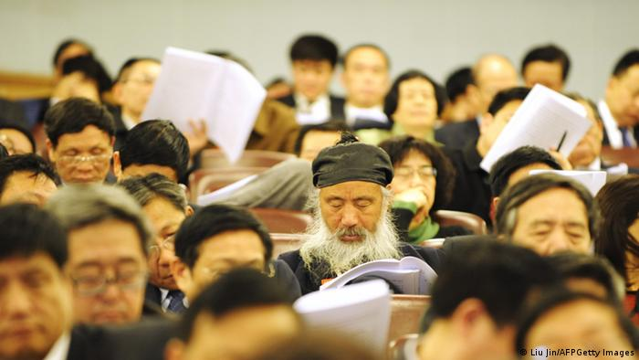 Delegates attend the opening session of the nine-day National People's Congress at the Great Hall of the People in Beijing on March 5, 2010.