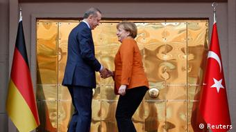 Turkey's Prime Minister Tayyip Erdogan and German Chancellor Angela Merkel shake hands during a welcoming ceremony in Ankara February 25, 2013. REUTERS/Altan Burgucu (TURKEY - Tags: POLITICS)