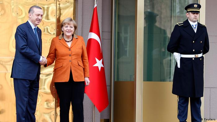 German Chancellor Angela Merkel shakes hands with Turkey's Prime Minister Tayyip Erdogan during a welcoming ceremony in Ankara February 25, 2013. REUTERS/Umit Bektas (TURKEY - Tags: POLITICS)