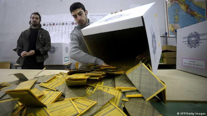 Workers open the ballots in a polling station FILIPPO MONTEFORTE/AFP/Getty Images)