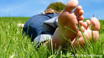 A person lying in a grassy field