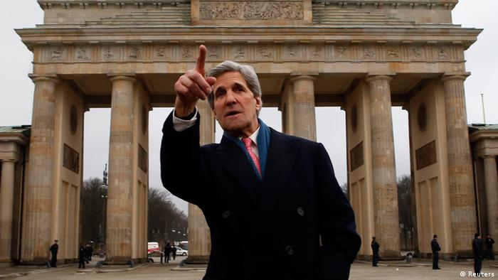 U.S. Secretary of State John Kerry gestures as he stands in front of the Brandenburg Gate in Berlin February 26, 2013. Kerry arrived in Berlin on Monday, a stop on a nine-nation, 11-day trip that will also take him to Paris, Rome, Ankara, Cairo, Riyadh, Abu Dhabi and Doha before he returns home on March 6. REUTERS/Fabrizio Bensch (GERMANY - Tags: POLITICS TPX IMAGES OF THE DAY)