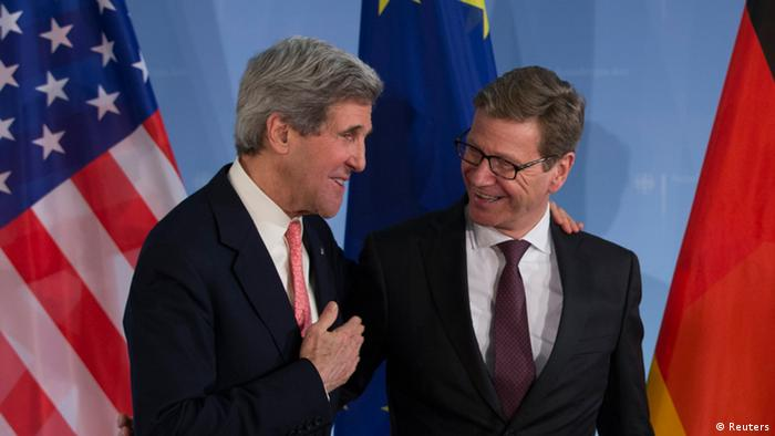 German Foreign Minister Guido Westerwelle (R) and U.S. Secretary of State John Kerry leave a news briefing after talks at the foreign ministry in Berlin February 26, 2013. Kerry said in Berlin on Tuesday he hopes Iran will choose at talks with major powers in Kazakhstan to move closer to a diplomatic solution on the Islamic Republic's nuclear ambitions. REUTERS/Thomas Peter (GERMANY - Tags: POLITICS)