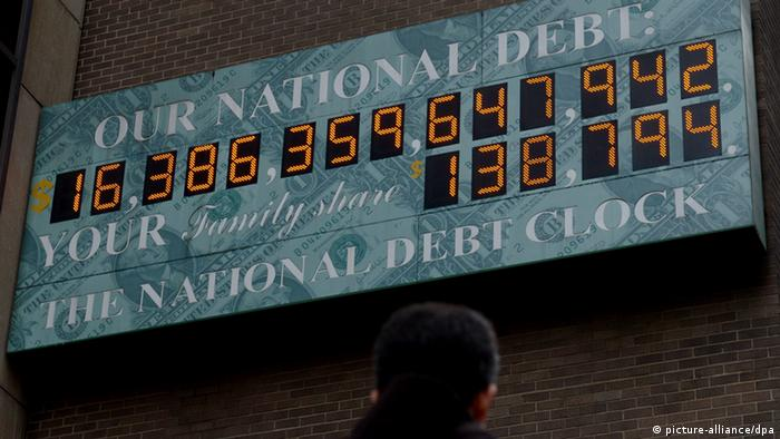 epa03521164 A view of the National Debt Clock in New York, New York, USA, 31 December 2012. The clock, which is privately operated, shows an estimate of the Untied States' national debt as well as an estimate of each family's share of that amount. EPA/JUSTIN LANE