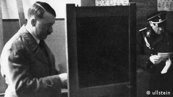 Adolf Hitler places his vote in a Königsberg voting booth on March 5, 1933