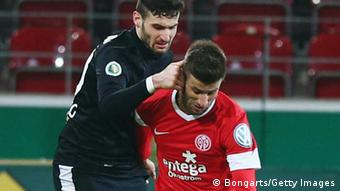 MAINZ, GERMANY - FEBRUARY 26: Marco Caligiuri (front) of Mainz is challenged by Daniel Caligiuri of Freiburg during the DFB Cup Quarter Final match between FSV Mainz 05 and SC Freiburg at Coface Arena on February 26, 2013 in Mainz, Germany. (Photo by Alex Grimm/Bongarts/Getty Images)